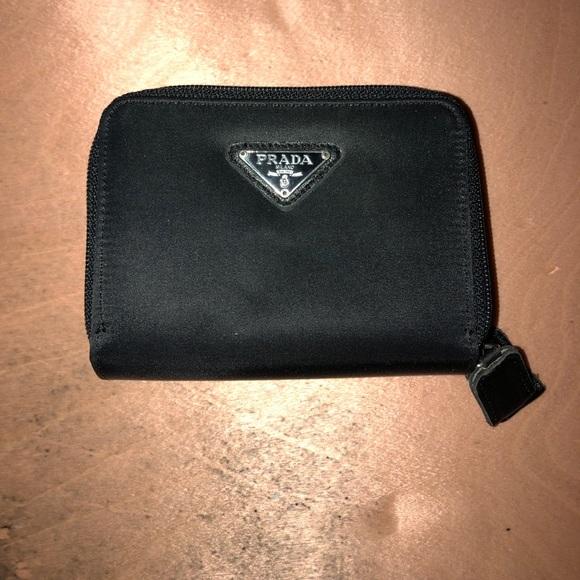 802c4a732c0d07 Prada nylon zip wallet. M_5a427e876bf5a618d20575f5